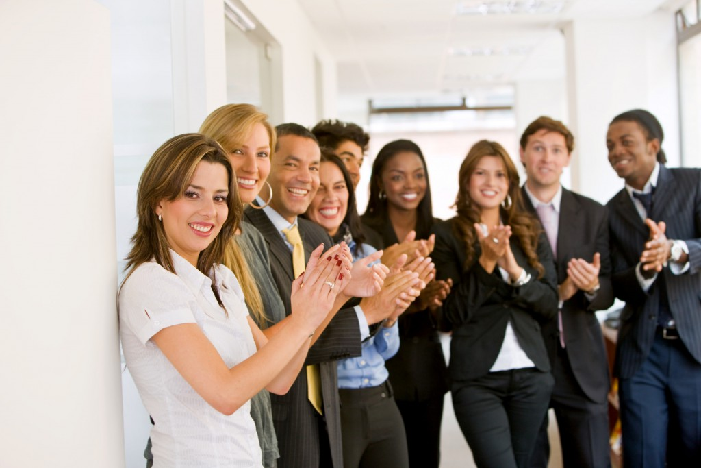 salespeople-clapping-for-their-successful-teammate